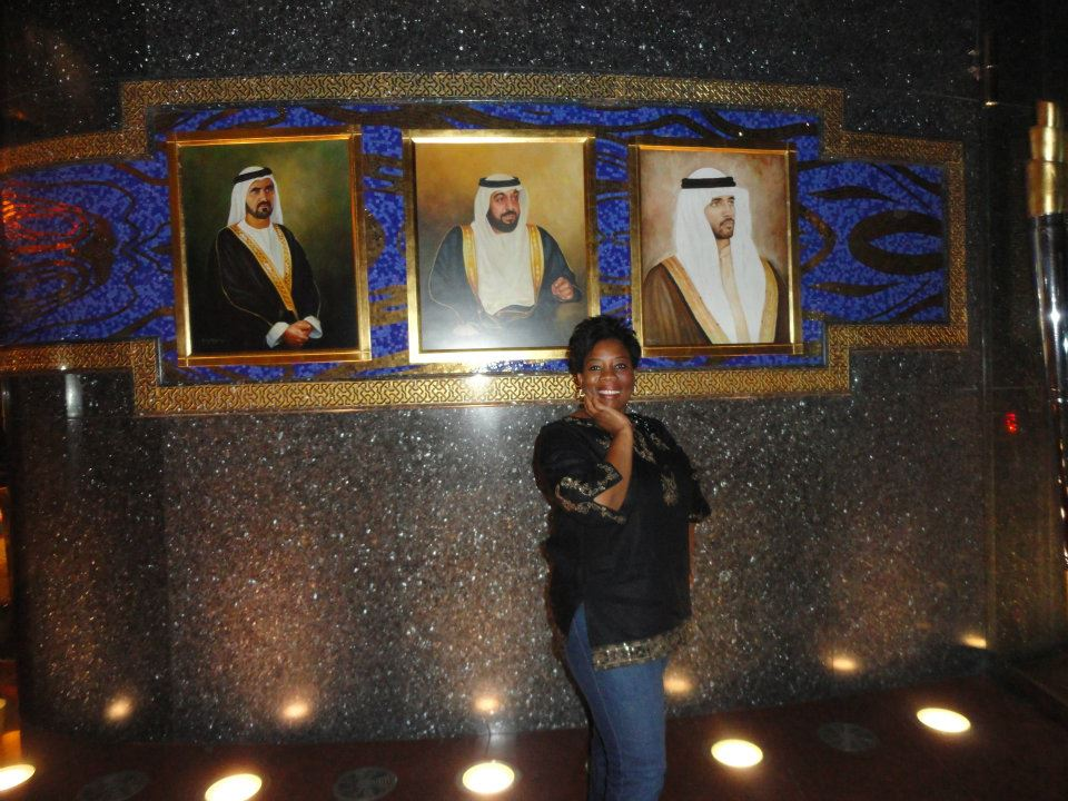 May Olusola in front of The Burj Al-Arab in Dubai