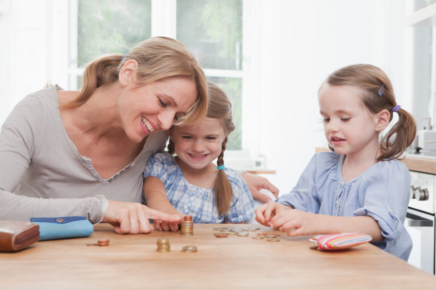 Mom and daughers with coins