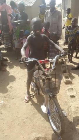 Godwin Musa on his new bicycle