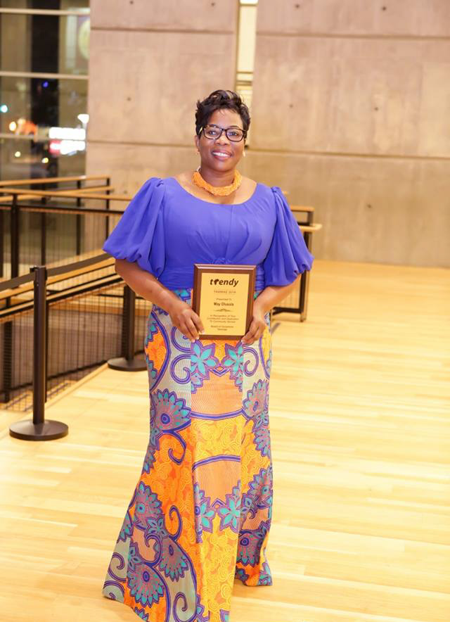 May Olusola after receiving a recognition  award